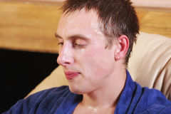 Guy dripping with sweat. Guy in blue dripping with sweat closeup photo stock photography