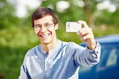 Guy with driving license Royalty Free Stock Photos
