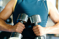 Guy with dumbbells Stock Photos