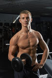 Guy with dumbbells in the gym Stock Photo