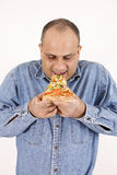 Guy eating pizza slice Royalty Free Stock Images