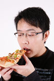 Guy eating pizza slice Royalty Free Stock Image