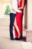 Guy embraces the girl in a red dress Stock Photography