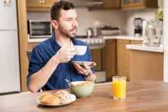 Guy enjoying coffee for breakfast Royalty Free Stock Image