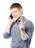 Guy enjoying a conversation over the cellphone Royalty Free Stock Photography