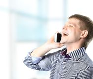 Guy enjoying a conversation over the cellphone Royalty Free Stock Image