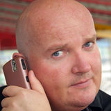 Guy enjoying his communication on mobile phone Stock Photography