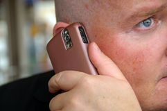 Guy enjoying his communication on mobile phone Stock Photos