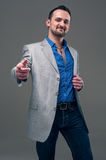 Guy in everyday jacket and jeans Royalty Free Stock Photography