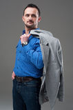 Guy in everyday jacket and jeans Royalty Free Stock Photo