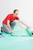 Guy examining mat Stock Photos
