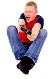 The guy excitedly playing video games Stock Image