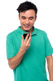 Guy exicted about his cellphone Stock Photo