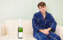 Guy in expectation of woman with sparkling wine Royalty Free Stock Photo