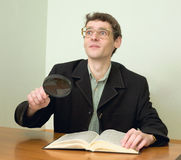 Guy in eyeglasses reads the book Royalty Free Stock Photography