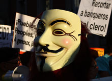 Guy Fawkes mask. The always-present mask of Guy Fawkes (the character from V for Vendetta) the indignados rally in Madrid, Spain on 15 October 2011, the global stock photo