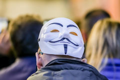Guy Fawkes mask. Imola, Italy - October 17, 2015:  Anonimous rear man wearing Guy Fawkes mask during a ITALIA 5 STELLE event in Imola. A political convention Royalty Free Stock Image