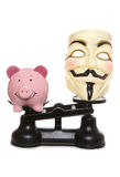 Guy fawkes mask with piggy bank Royalty Free Stock Photography