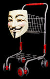 Guy fawkes mask with a shopping trolley. On black background Royalty Free Stock Photo