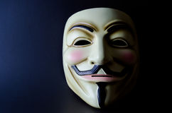 Guy Fawkes Mask Split Lighting. Guy Fawkes mask on black background with mask light on one side and dark on the other side. Symbol of recent underground Royalty Free Stock Image
