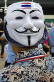 Guy Fawkes mask with Thai Flag. BANGKOK, July 14: Anti-government protestors supporting the white-mask movement against corruption in the Yingluck Shinawatra Stock Photography
