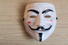 Guy Fawkes Mask on a Wooden Background Royalty Free Stock Photos