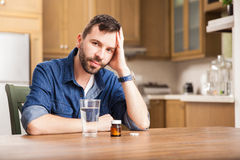 Guy feeling unwell at home Stock Photos