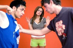 Guy Fight. Two guys fighting over a girl royalty free stock photography
