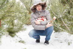 The guy among fir-trees with a gift Stock Photo