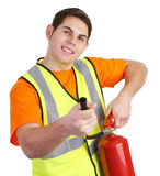 Guy with fire extinguisher. A guy wearing a hiviz jacket and holding a fire extinguisher Royalty Free Stock Photos
