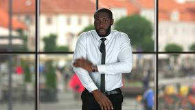 Guy fixing tie. Formally dressed black man. Business fashion tips stock footage