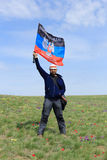 Guy with the flag DPR in the tulip field, Rostov region, Russia Stock Photography