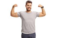 Guy flexing his biceps Stock Photo