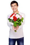 Guy with flowers Stock Photos