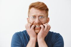 Free Guy Freaking Out, Feeling Worried And Scared Someone Know His Secret, Biting Fingernails And Frowning Staring Intense At Stock Photo - 136329370