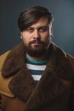 Guy in fur coat Royalty Free Stock Photo