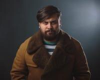Guy in fur coat Stock Photo