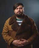 Guy in fur coat Stock Photography