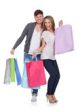 Guy and gal brings shopping bags Royalty Free Stock Photos