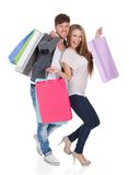 Guy and gal brings shopping bags Stock Images