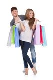 Guy and gal brings shopping bags Royalty Free Stock Image