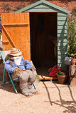 Guy and the Garden Shed. A guy made of straw and old clothing sitting on a deckchair outside of the garden shed Stock Images