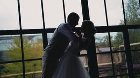The guy gently supports his girlfriend in his arms. The girl bends back. A beautiful couple in love. stock video