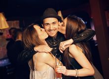 Guy Gets a Kiss from Attractive Party Girls Royalty Free Stock Photo