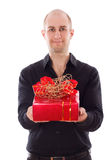 Guy with gift box. Royalty Free Stock Images