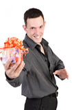The guy with a gift isolated on a white background Royalty Free Stock Photo