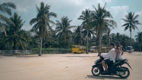 Guy girl appears on black motorbike woman gets off runs away stock footage