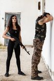 Guy with girl on a battlefield Royalty Free Stock Photos
