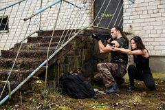 Guy with girl on a battlefield. War, conflict. Guy with girl on a battlefield Royalty Free Stock Photography
