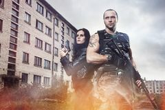 Guy with girl on a battlefield Royalty Free Stock Photo